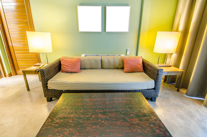Classic sofa in a stylish hotel room and lamp stock image