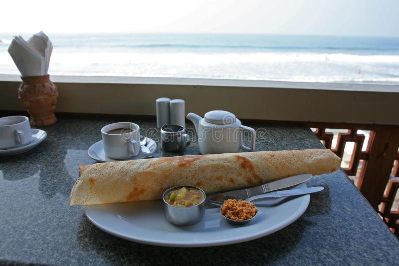 Classic South India cuisine for breakfast overlooking the beach stock images