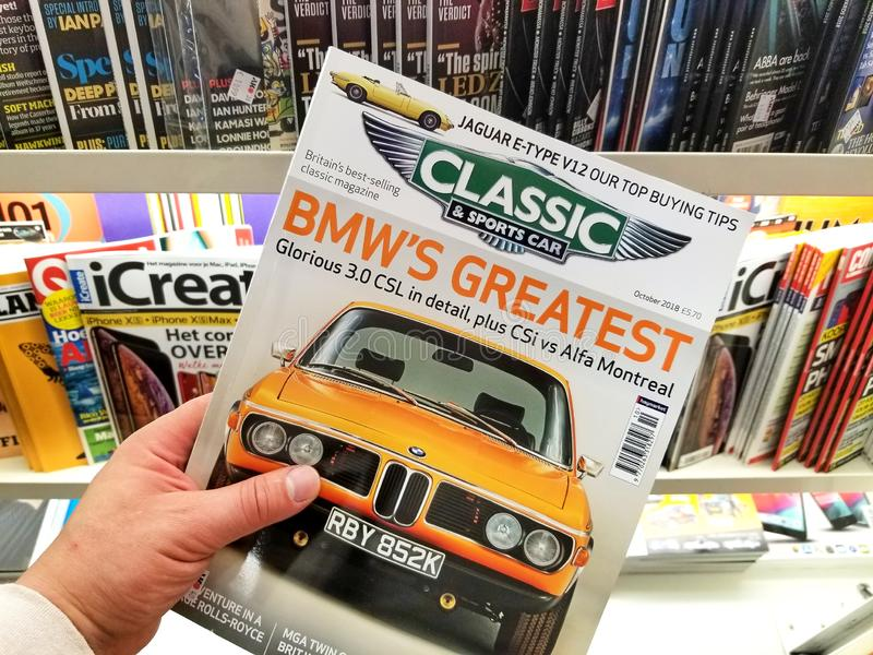 Classic and Sports Car magazine in a hand royalty free stock images