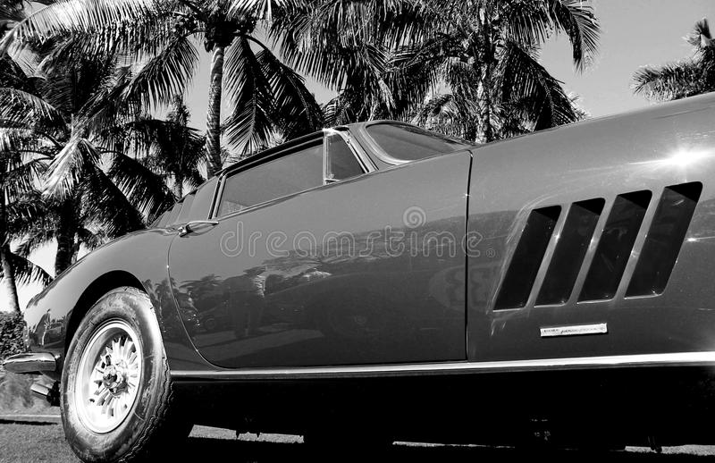 Classic sportscar side. Side view. Classic 1960s Ferrari 275 GTB4. outdoors on a sunny day. monochromatic in black and white stock photo