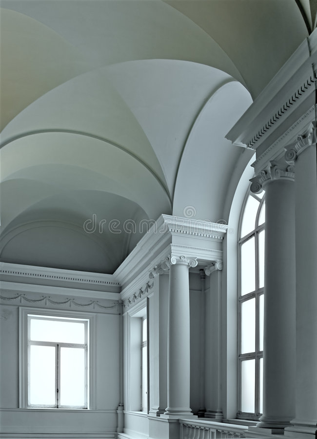 Classic staircase. In ancient house with light throw windows stock image