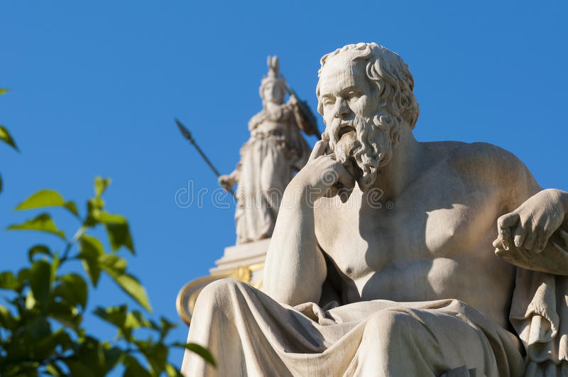 Classic statue Socrates. Classical statue of Socrates from side with athena statue above and back stock photos