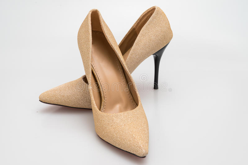 Classic stiletto high heels shoes in golden texture design. Classic stiletto high heels shoes in golden texture royalty free stock images