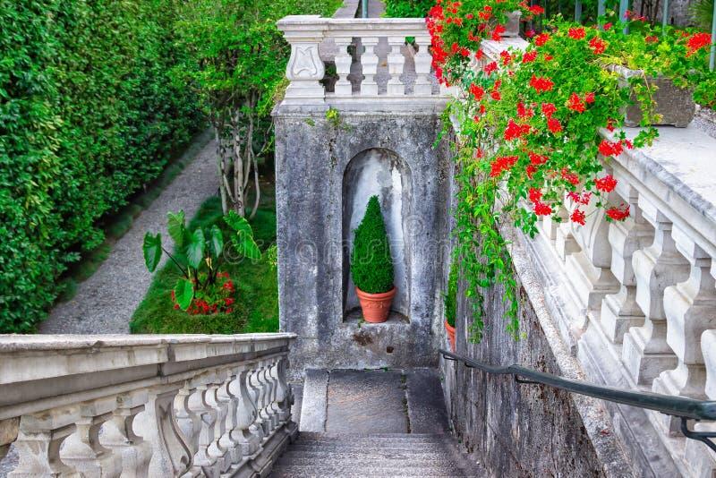 Classic stone stairs in beautiful garden of villa Carlotta, Como royalty free stock image