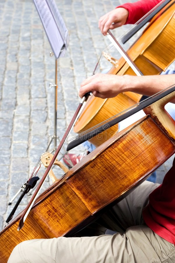 Classic street music. Detail of street music cello players royalty free stock images