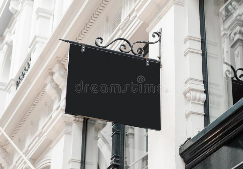 Classic style blank hanging company wall signboard mockup stock image