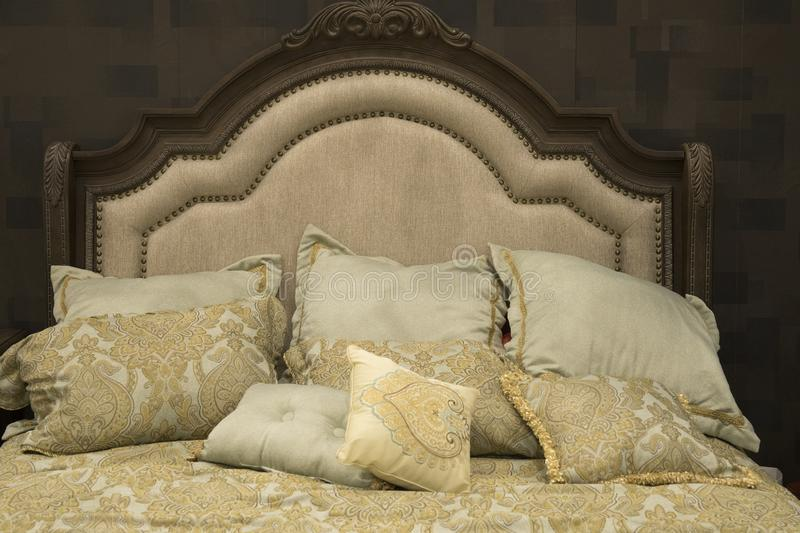 Classic style hotel luxury bed with cozy pillows royalty free stock photo