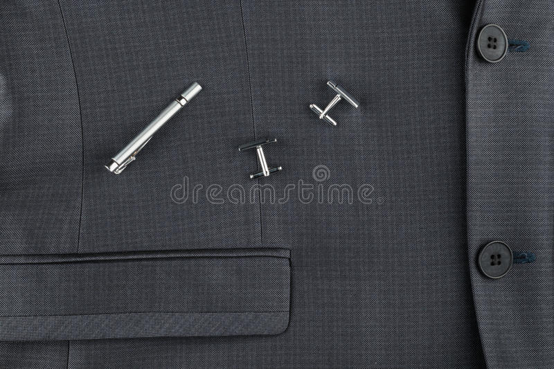 Classic suit, cufflinks and tie clip, close-up. royalty free stock image