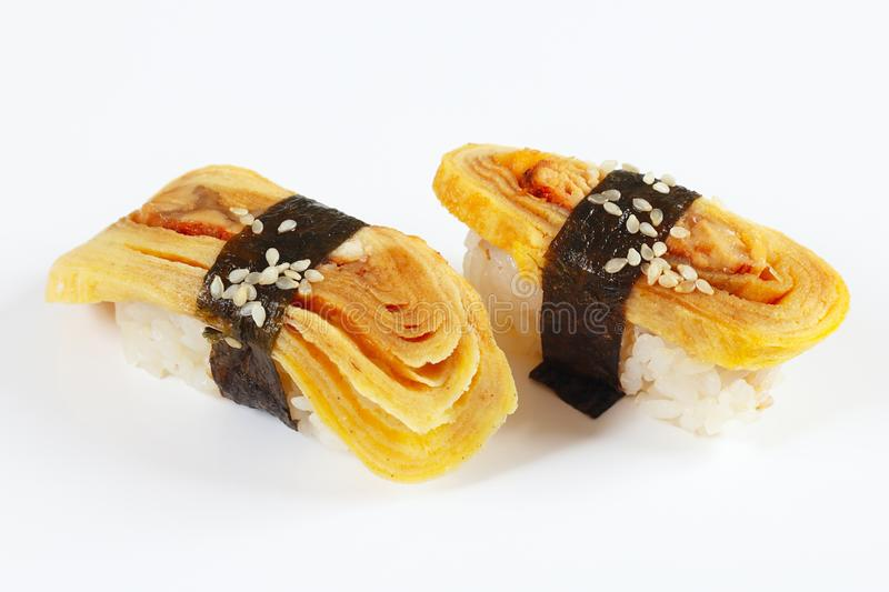 Classic sushi with japanese omelet and eel on white background close up. royalty free stock photography