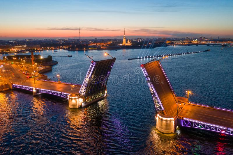 Classic symbol of St. Petersburg White Nights - a romantic view of the open Palace Bridge, which spans between - the spire of royalty free stock image