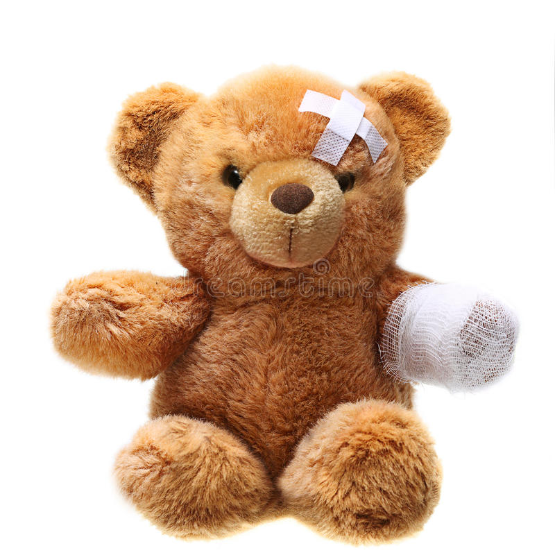 Classic teddy bear with bandages. Isolated on white background stock photo