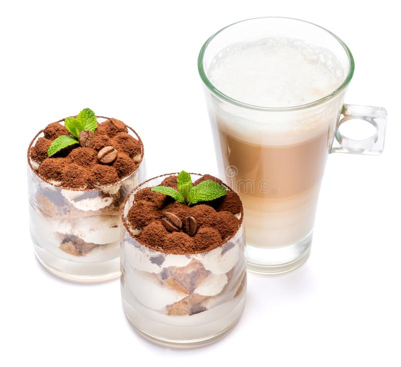 Classic tiramisu dessert in a glass and cup of coffee isolated on a white background with clipping path. Classic italian tiramisu dessert in a glass and cup of stock photos