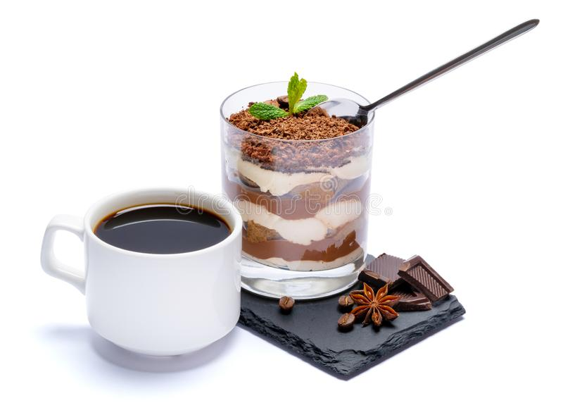 Classic tiramisu dessert in a glass cup and pieces of chocolate on stone cutting board on white background with clipping. Path embedded royalty free stock photography