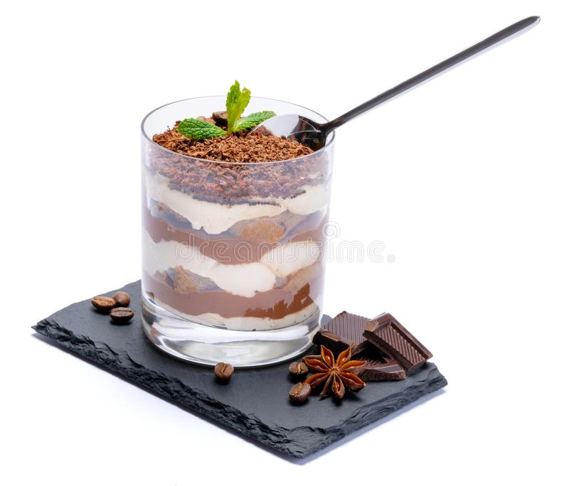 Classic tiramisu dessert in a glass cup and pieces of chocolate on stone cutting board on white background with clipping. Path embedded royalty free stock photos
