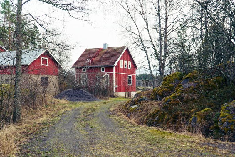 Classic traditional red wooden house in Scandinavia countryside, Finland. stock image