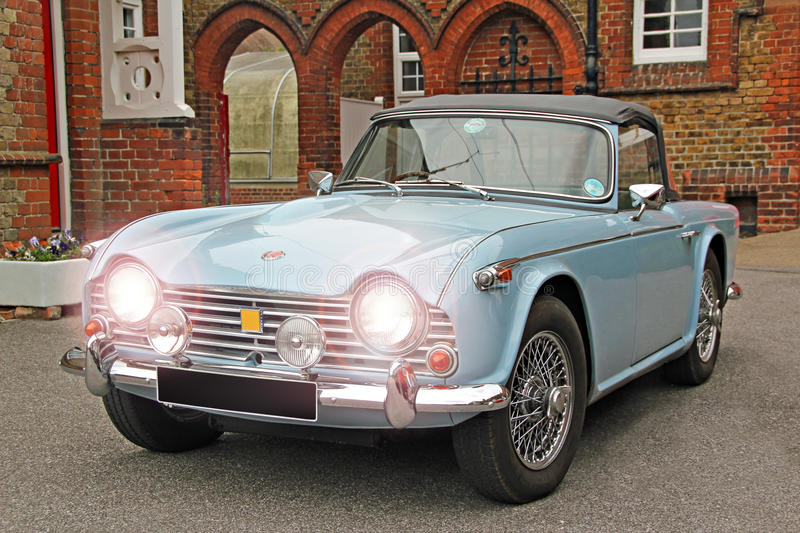 Classic triumph tr4 car. Photo of a british classic car triumph tr4 with wedgwood blue colour and headlights on royalty free stock image