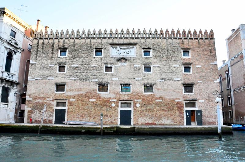 Classic Venice channel view with typical buildings, colorful windows, bridges and boats royalty free stock photo