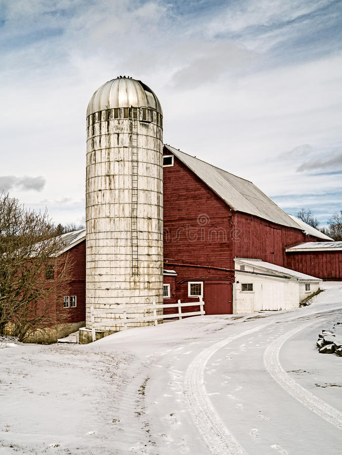 Classic Vermont farm with silo and red barn stock images