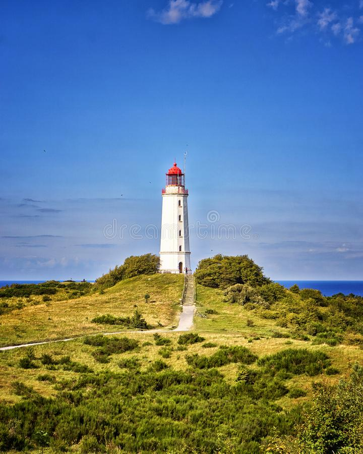 Classic view of the famous Lighthouse Dornbusch on the beautiful island Hiddensee in summer, Baltic Sea, Mecklenburg-Vorpommern,. Germany, architecture stock photo