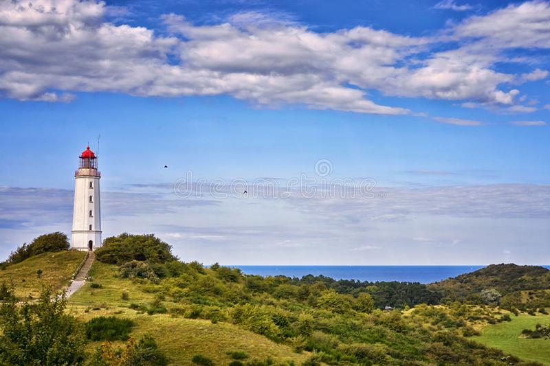 Classic view of the famous lighthouse Dornbusch on the beautiful island Hiddensee with a view of the Baltic Sea, Mecklenburg-. Vorpommern, Germany, coast, europe stock image