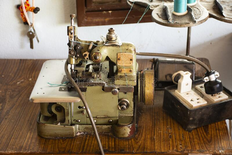 Classic vintage antique retro overlock and safety stitch machine sewing for thai people work at home in countryside on August 20,. PHATTHALUNG, THAILAND - AUGUST royalty free stock photos