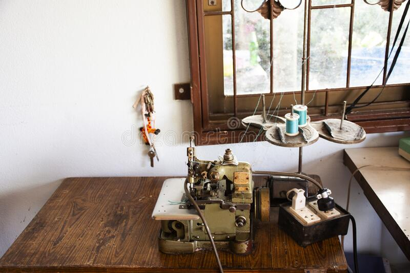 Classic vintage antique retro overlock and safety stitch machine sewing for thai people work at home in countryside on August 20,. PHATTHALUNG, THAILAND - AUGUST stock images