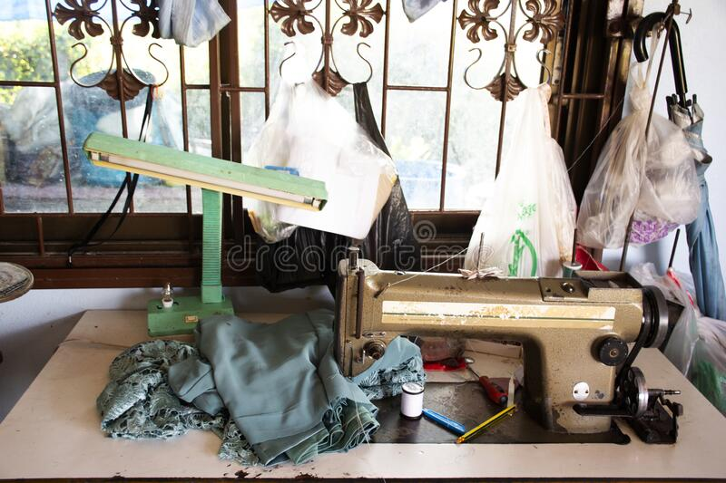 Classic vintage antique retro sewing fabric machine for thai people work at home and repair clothes at house countryside on August. PHATTHALUNG, THAILAND royalty free stock photo