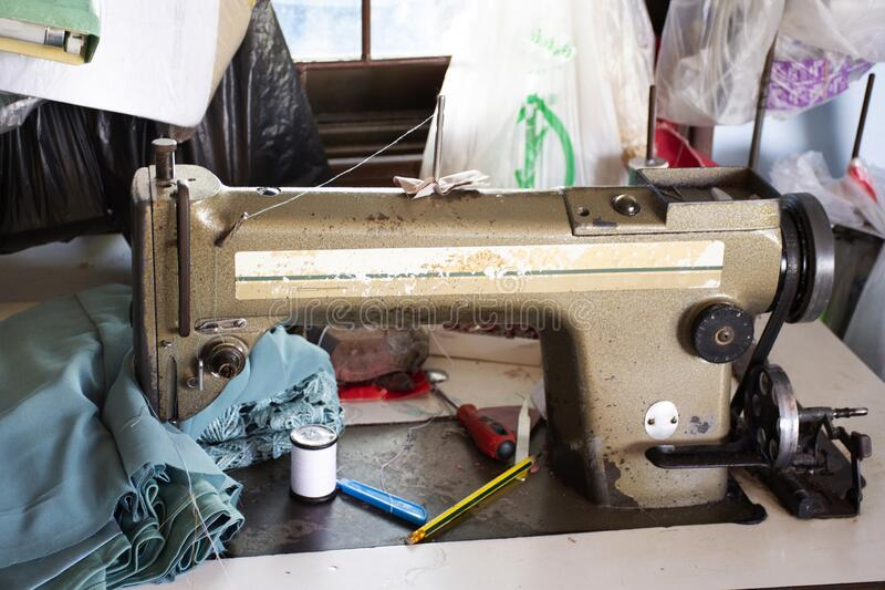Classic vintage antique retro sewing fabric machine for thai people work at home and repair clothes at house countryside on August. PHATTHALUNG, THAILAND royalty free stock image
