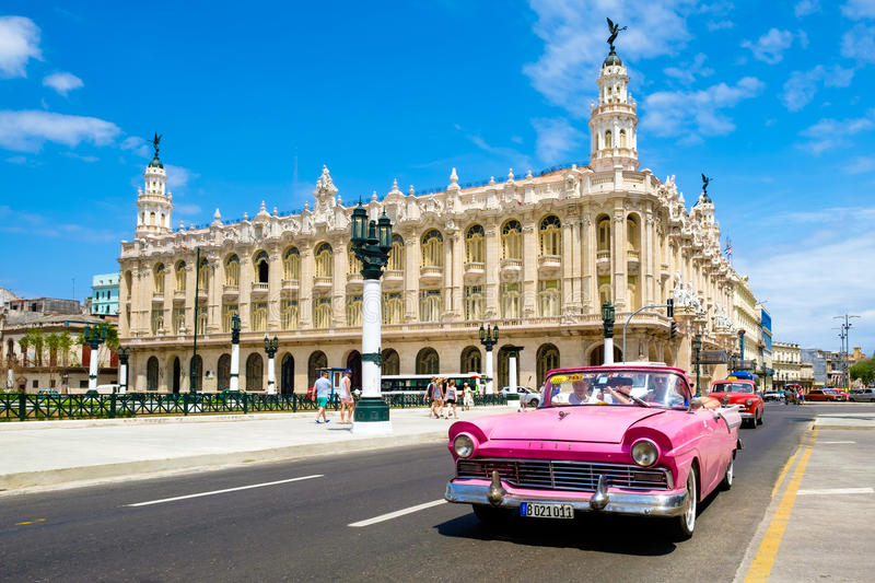 Classic vintage car next to the beautiful Great Theater of Havan stock photography