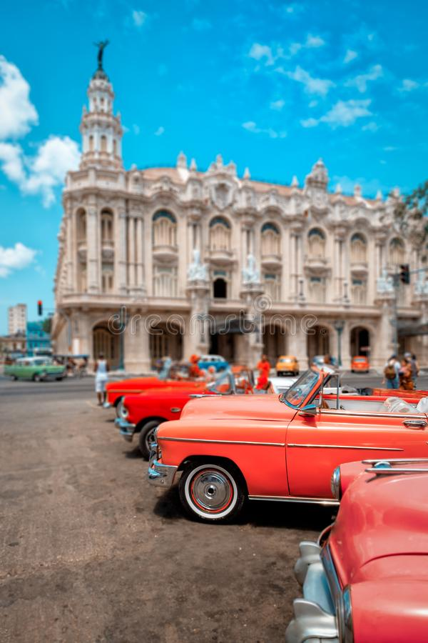 Classic vintage cars next to the beautiful Great Theater of Havana. HAVANA,CUBA- APRIL 20,2016 : Classic vintage cars next to the beautiful Great Theater of stock image