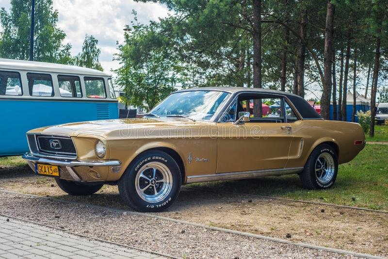 Classic vintage golden Ford Mustang parked stock image