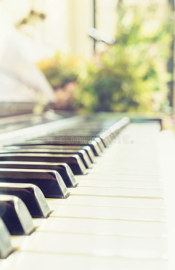 Classic vintage old piano keyboard shallow depth. Of field stock photos