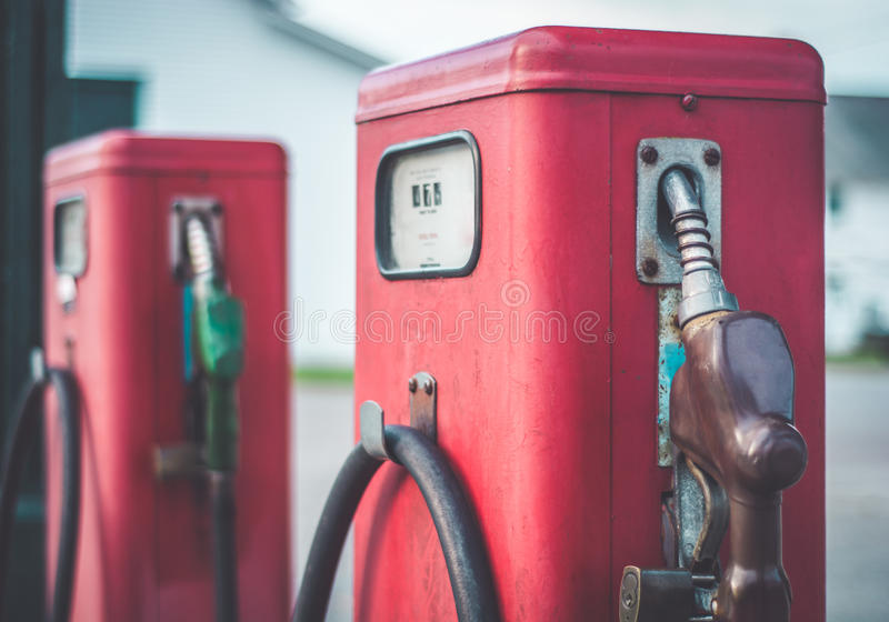 Classic vintage red fuel pumps. A piece of Americana. Classic vintage red fuel pumps stock images