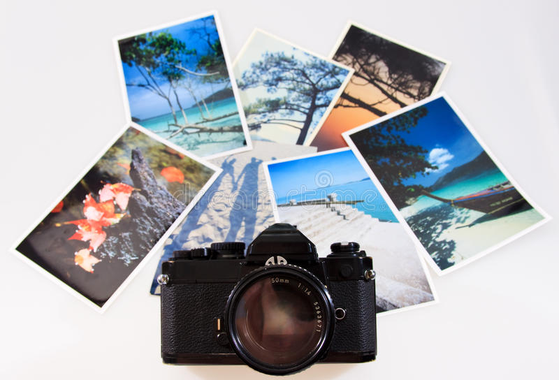 Classic vintage slr film camera with photographs stock photos