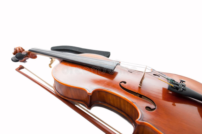 Classic violin with the fiddlestick isolated on white. Classic violin with the fiddlestick on white stock photos