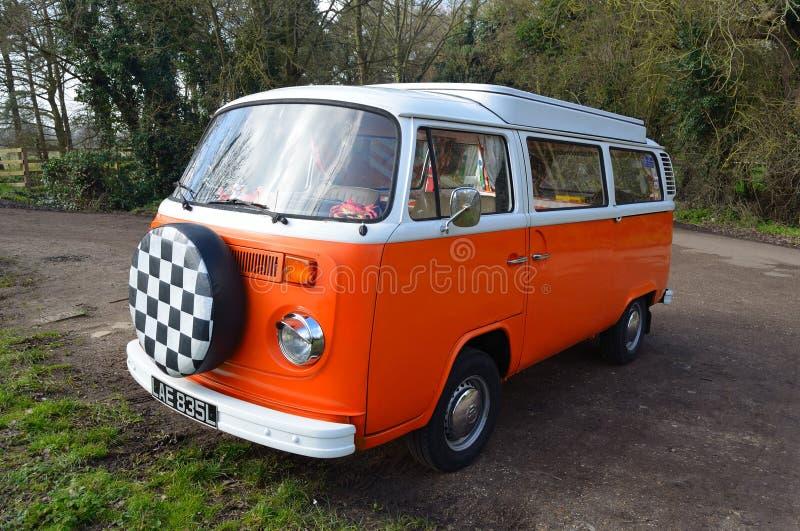 Classic Volkswagen Camper Van in White and Orange. stock photography