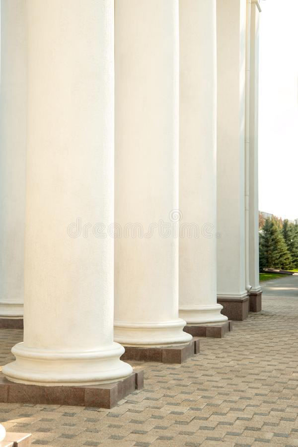 Classic white cylindrical columns stock image