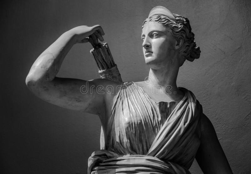 Classic white marble statuette Diana of Versailles.  stock photos