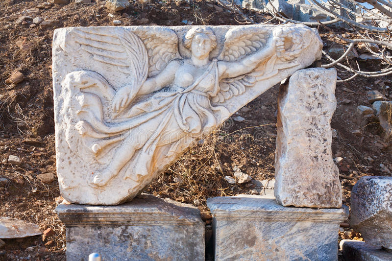 Classic White Roman angel bas-reflief wall decoration in Temple stock images