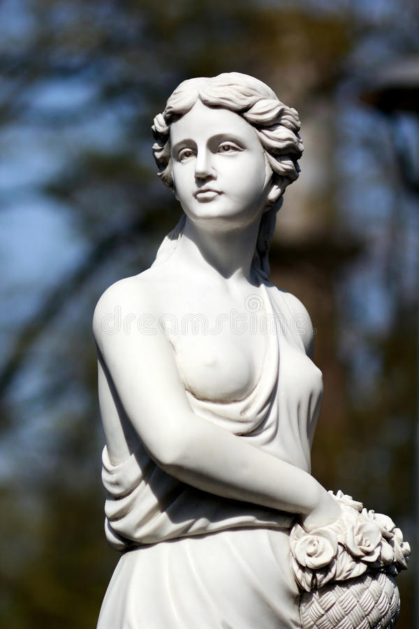 Classic white statue of a Demeter young lady stock images