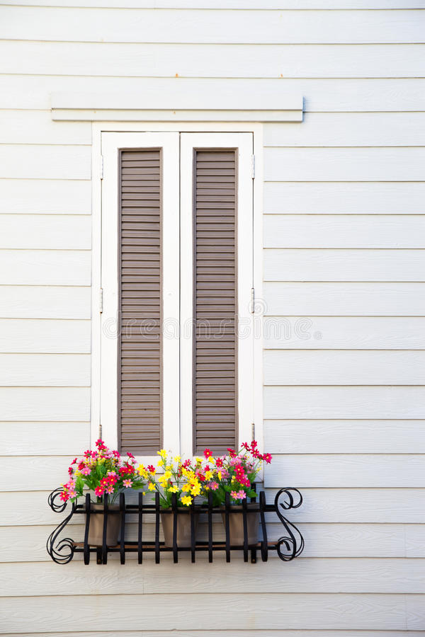 Classic white window with flower planter box stock image