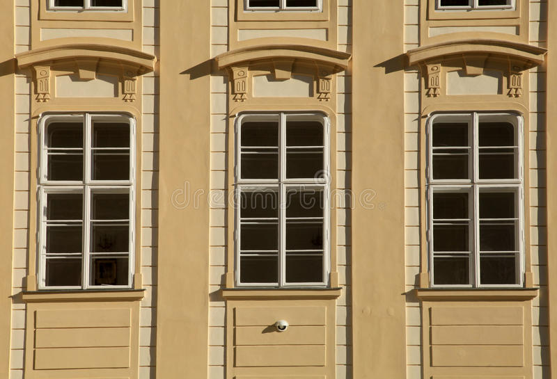 Classic windows and facade of building in Prague Castle stock image