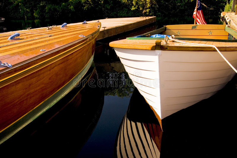 Classic Wood Boats Docked stock images