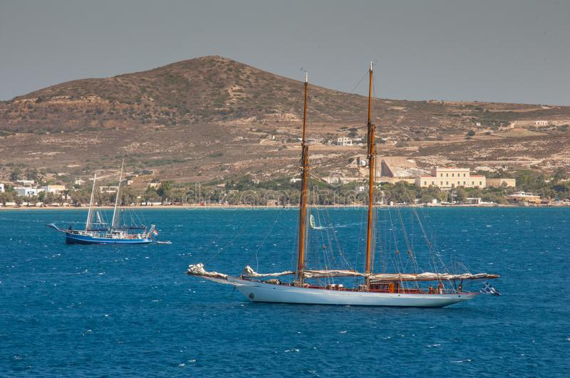 Classic wood sailing vessel on blue sea royalty free stock photo