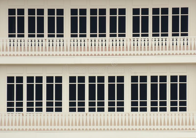 Classic wood window at a white concrete building. Background stock images