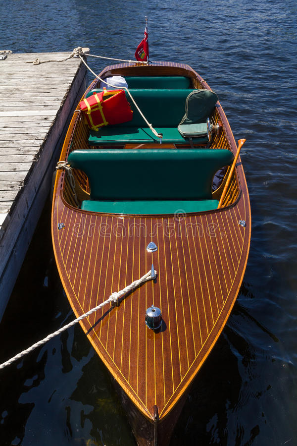 Classic wooden boat with stripes royalty free stock photos