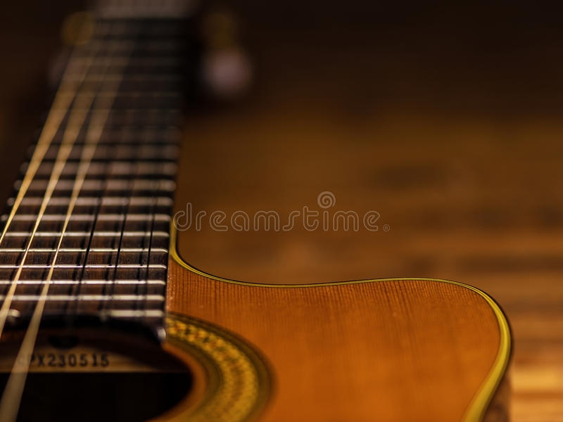CLassic wooden guitar body close-up view stock photography