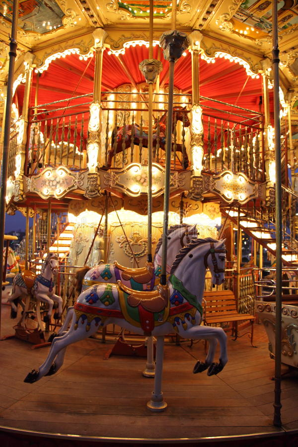 Classic wooden merry-go-round. Night view of merry-go-round with wooden horses in Paris with speed effect royalty free stock photo