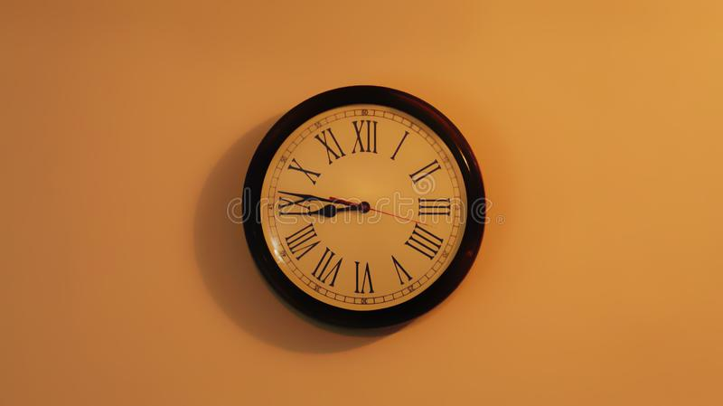 Classic wooden retro clock on display in the center of the wall stock photography
