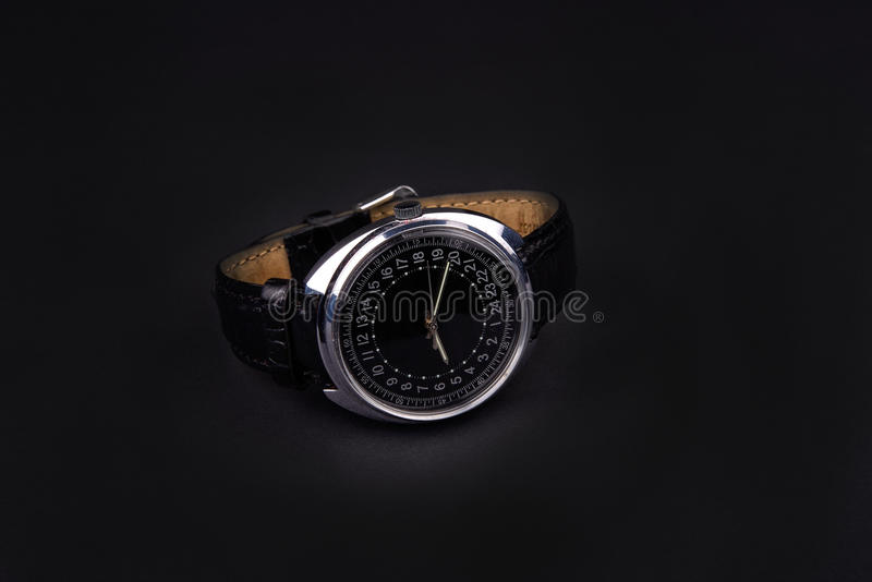 Classic wristwatch for man on black background. Classic wristwatch for man on black royalty free stock images